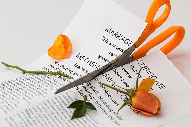 marriage certificate being cut by scissors