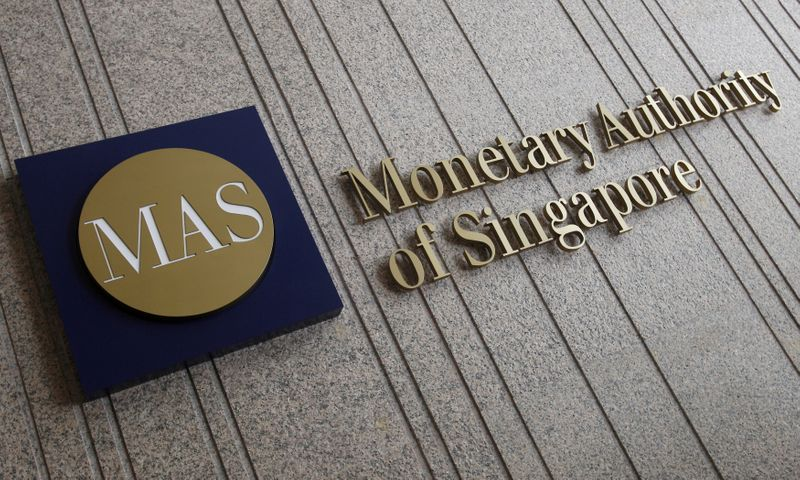Singapore central bank tightens policy in surprise move